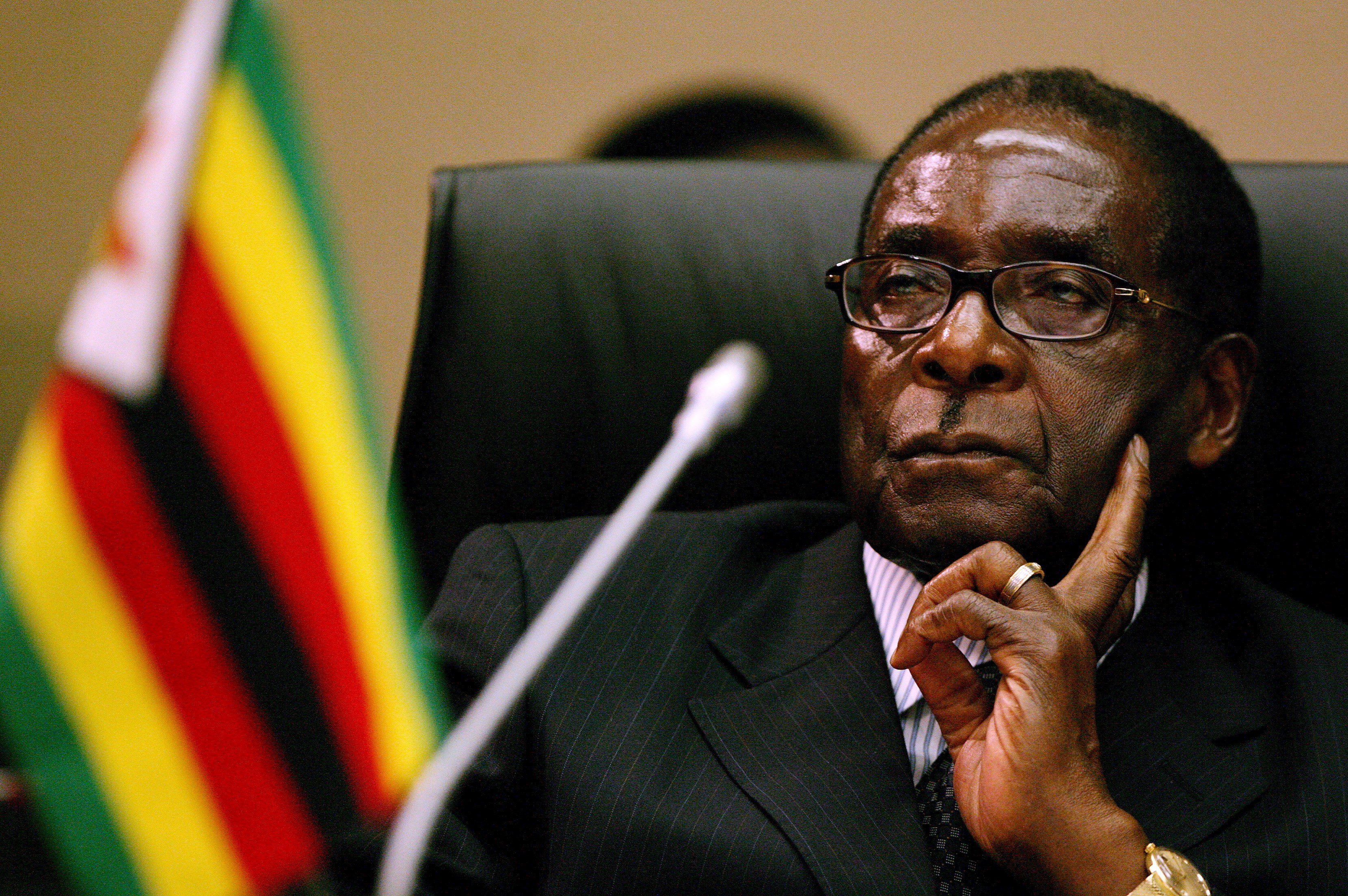 epa01648158 (FILE) A file photograph showing Zimbabwean President Robert Mugabe attending the Southern African Development Community (SADC) Extraordinary Summit of Heads of State and Government at the Sandton Convention Centre in Johannesburg, South Africa, 09 November 2008. President Robert Mugabe said that Zimbabwe could hold fresh elections in two years if a new constitution is approved in a referendum, in an interview with state media on 26 February 2009. Mugabe, said in the Herald newspaper that the new unity government with Prime Minister Morgan Tsvangirai, formed only two weeks ago, was a temporary solution until the parties could agree on a new charter and fresh polls. EPA/JON HRUSA